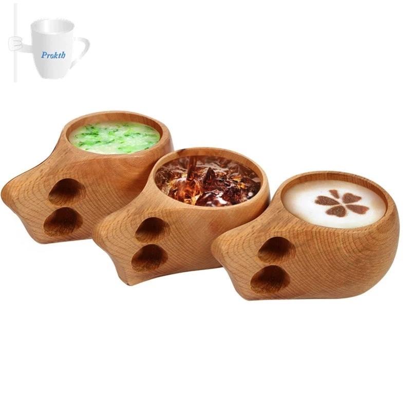 Kuksa coffee mug in use